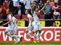 FC Koln's Japanese striker Yuya Osako celebrates scoring the 1-0 goal with his team-mates during German first division Bundesliga football match 1 FC Koln vs VfL Wolfsburg at the RheinEnergieStadion in Cologne, western Germany on May 23, 2015