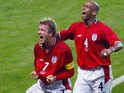 English midfielder David Beckham (L) and his teammate defender Trevor Sinclair jubilate after David Beckham scored a goal during the Group F first round match Argentina/England of the 2002 FIFA World Cup in Korea and Japan, 07 June 2002