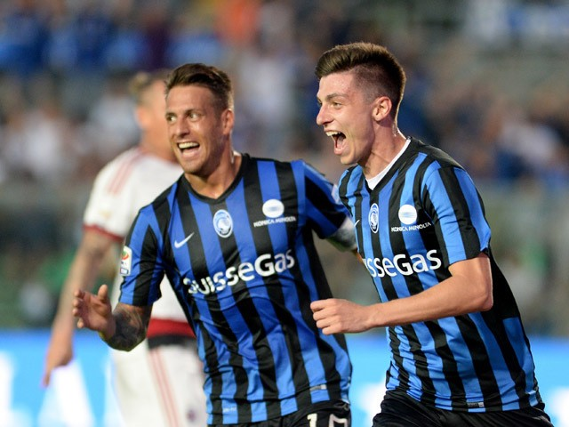 Daniele Baselli of Atalanta BC celebrates after scoring his opening goal during the Serie A match between Atalanta BC and AC Milan at Stadio Atleti Azzurri d'Italia on May 30, 2015