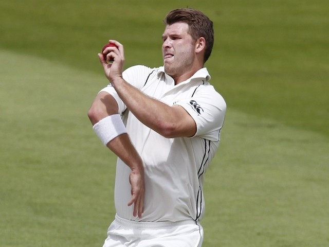 New Zealand's Corey Anderson bowling during play on the fourth day of the first cricket Test match between England and New Zealand at Lord's cricket ground in London on May 24, 2015