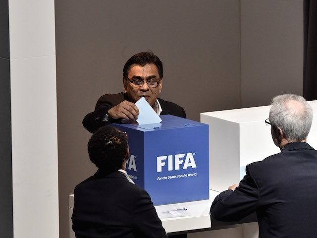 An official casts his vote during the FIFA presidency election on May 29, 2015
