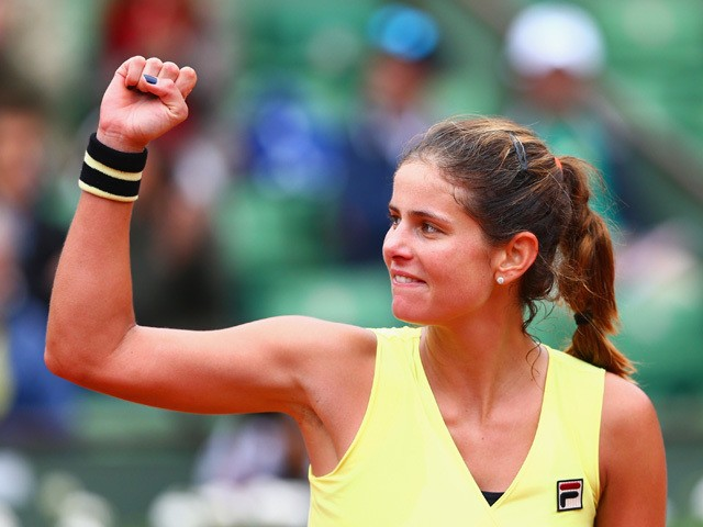 Julia Goerges of Germany celebrates victory during her Women's Singles match against Caroline Wozniacki of Denmark on day five of the 2015 French Open at Roland Garros on May 28, 2015