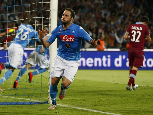 Napoli's forward from Argentina and France Gonzalo Higuain celebrates after scoring during the Italian Serie A football match SSC Napoli vs SS Lazio on May 31, 2015