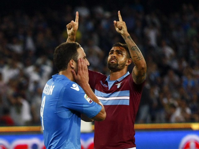 Napoli's French Argentinan forward Gonzalo Higuain reacts after missing a penalty as Lazio's Brazilian defender Mauricio gestures during the Italian Serie A football match SSC Napoli vs SS Lazio on May 31, 2015