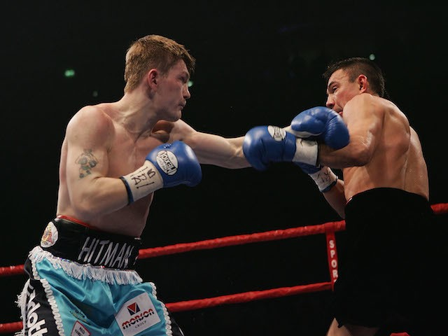 Ricky Hatton (L) in action against Kostya Tszyu during the IBF light welterweight title fight at the MEN Arena on June 4, 2005