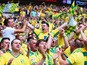 Norwich City fans celebrate during the Sky Bet Championship Playoff Final between Middlesbrough and Norwich City at Wembley Stadium on May 25, 2015