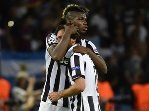 Juventus' midfielder Andrea Pirlo and Juventus' French midfielder Paul Pogba reacts after the UEFA Champions League Final football match between Juventus and FC Barcelona at the Olympic Stadium in Berlin on June 6, 2015
