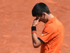 Serbia's Novak Djokovic reacts after a point against Switzerland's Stanislas Wawrinka during their men's final match of the Roland Garros 2015 French Tennis Open in Paris on June 7, 2015