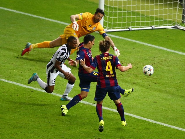 Luis Suarez of Barcelona scores his team's second goal during the UEFA Champions League Final between Juventus and FC Barcelona at Olympiastadion on June 6, 2015