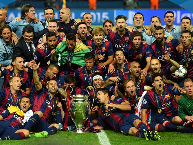 The Barcelona team celebrate victory with the trophy after the UEFA Champions League Final between Juventus and FC Barcelona at Olympiastadion on June 6, 2015
