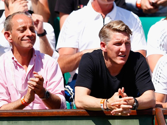 Bastian Schweinsteiger (R) watches Ana Ivanovic of Serbia in her Women's Semi final match against Lucie Safarova of Czech Repbulic on day twelve of the 2015 French Open at Roland Garros on June 4, 2015