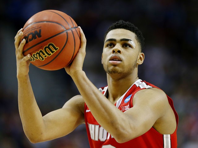 D'Angelo Russell #0 of the Ohio State Buckeyes takes a free htrow in the second half against the Arizona Wildcats during the third round of the 2015 NCAA Men's Basketball Tournament at Moda Center on March 21, 2015