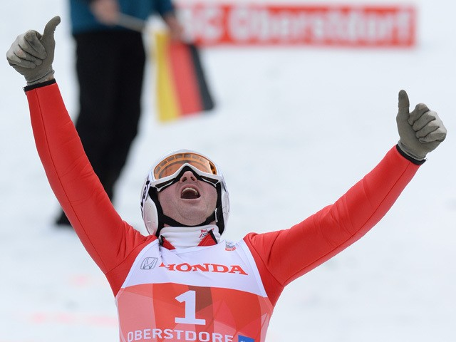 British former ski jumper Michael Edwards, known as Eddie 'The Eagle' reacts after jumping for fun during the Four-Hills-Tournament (Vierschanzentournee) in Oberstdorf, southern Germany on December 29, 2013