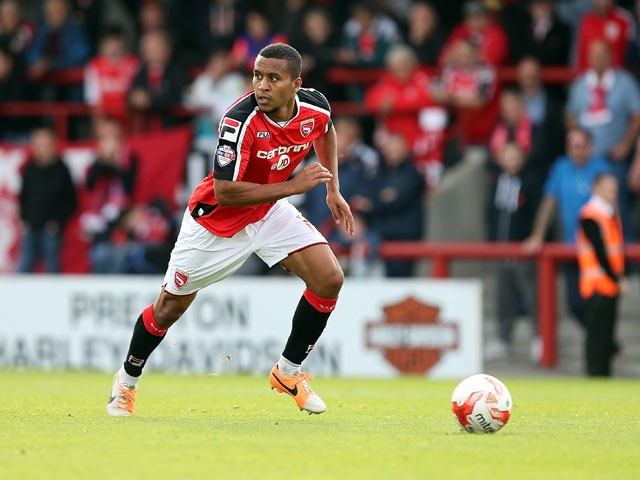 Joe Widdowson of Morecambe in action during the Sky Bet League Two match between Morecambe and Northampton Town at Globe Arena on September 27, 2014