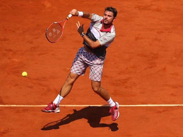 Stanislas Wawrinka plays an overhead shot during the French Open semi-final against Jo-Wilfried Tsonga at Roland Garros on June 5, 2015