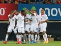 Costa Rica's players celebrate a goal during the friendly football match Spain vs Costa Rica at the Reino de Leon stadium in Leon on June 11, 2015