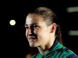 Gold medalist Katie Taylor of Ireland walks to the medal ceremony for the Women's Light (60kg) Boxing final bout on Day 13 of the London 2012 Olympic Games at ExCeL on August 9, 2012