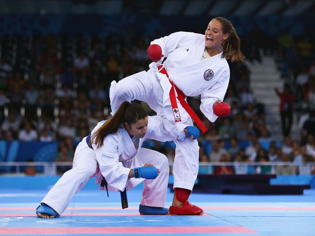 Elena Quirici of Switzerland (blue) competes with Alisa Theresa Buchinger of Austria (red) in the Women's Karate Kumite -68kg semi finals during day two of the Baku 2015 European Games at Crystal Hall on June 14, 2015