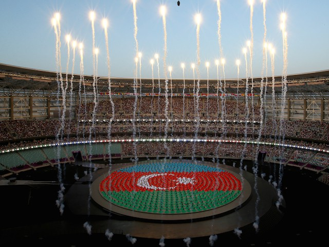 Performers depict the national flag of Azerbaijan during the Opening Ceremony for the Baku 2015 European Games at the National Stadium on June 12, 2015