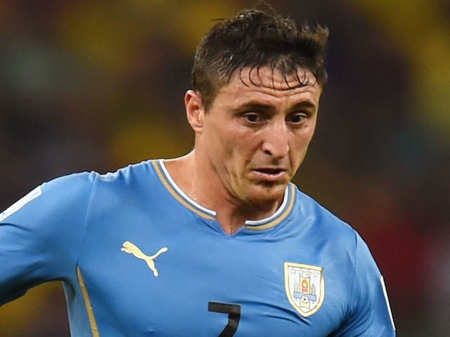 Cristian Rodriguez of Uruguay controls the ball during the 2014 FIFA World Cup Brazil round of 16 match between Colombia and Uruguay at Maracana on June 28, 2014