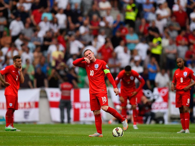 Captain Wayne Rooney of England prepares to restart after conceding the first goal during the UEFA EURO 2016 Qualifier between Slovenia and England on at the Stozice Arena on June 14, 2015