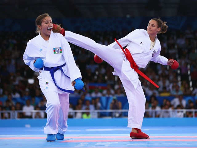 Irina Zaretska of Azerbaijan (blue) competes with Masa Martinovic of Croatia (red) in the Women's Karate Kumite +68kg gold medal match during day two of the Baku 2015 European Games at Crystal Hall on June 14, 2015