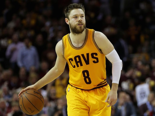 Matthew Dellavedova #8 of the Cleveland Cavaliers controls the ball against the Golden State Warriors during Game Three of the 2015 NBA Finals at Quicken Loans Arena on June 9, 2015