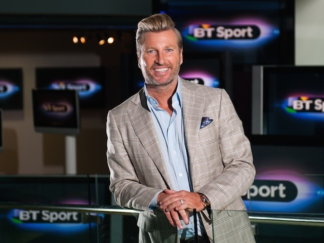Robbie Savage poses for a BT Sport photo