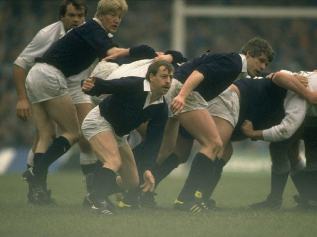 Roy Laidlaw of Scotland passes the ball out of a scrum during the Five Nations Championship match against England at Twickenham in London in 1987