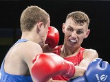 Ireland's Sean McComb (red) fights with Ukraine's Tymur Beliak during the mens light (60kg) round of 32 boxing fight at the 2015 European Games in Baku on June 18, 2015