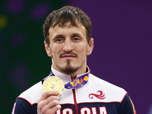 Gold medalist Aleksandr Bogomoev of Russia stands on the podium during the medal ceremony for the Men's Wrestling 61kg freestyle on day six of the Baku 2015 European Games at the Heydar Aliyev Arena on June 18, 2015