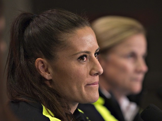 USA defender Ali Krieger (L) listens to questions with coach Jill Ellis during a news conference at the 2015 FIFA Women's World Cup in Vancouver on June 15, 2015