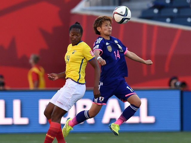 Japan's midfielder Asuna Tanaka (R) and Ecuador's forward Carina Caicedo vie for the ball during their Group C football match of the 2015 FIFA Women's World Cup in Winnipeg, Manitoba on June 16, 2015