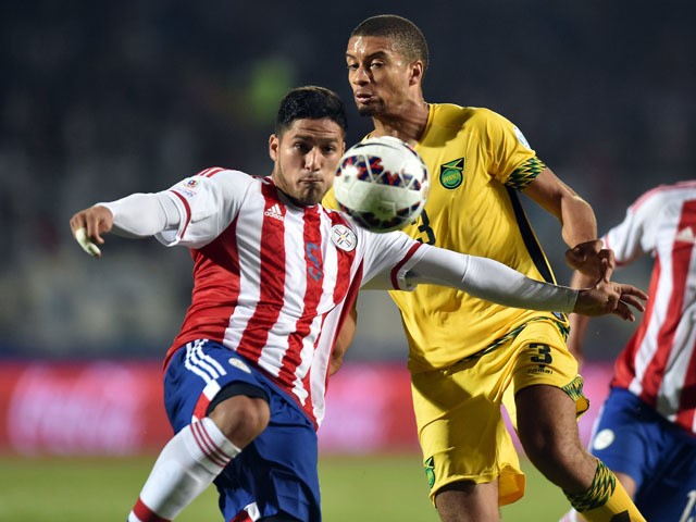 Paraguay's defender Bruno Valdez (L) and Jamaica's defender Michael Hector vie during their 2015 Copa America football championship match, in Antofagasta, Chile, on June 16, 2015