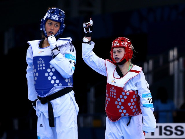 Charlie Maddock of Team GB celebrates after beating Italy's Erica Nicoli to qualify for the semi-finals of the women's -49kg taekwondo at the European Games in Baku