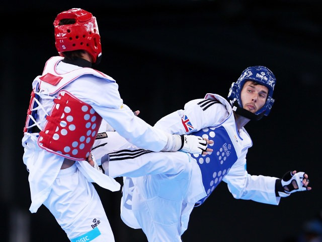 Martin Stamper of Team GB goes for a kick against Czech Republic's Filip Grgic during their preliminary fight at the 2015 European Games in Baku