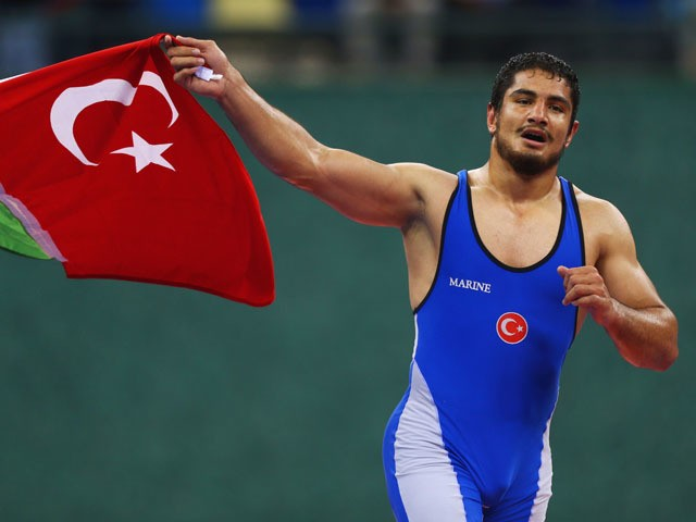 Taha Akgul of Turkey celebrates winning gold against Aleksei Shemarov of Belarus during the Men's Wrestling 125kg freestyle final on day six of the Baku 2015 European Games at the Heydar Aliyev Arena on June 18, 2015