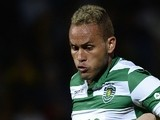 Sporting's Brazilian defender Ewerton (L) vies with Pacos Ferreira's midfielder Vasco Rocha during the Portuguese league football match FC Pacos de Ferreira vs Sporting CP at the Capital do Movel stadium in Pacos de Ferreira on April 4, 2015