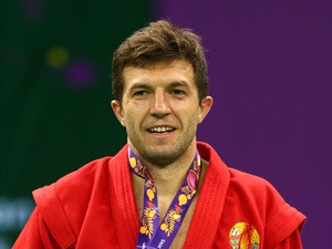Stsiapan Papou of Belarus poses with his gold medal won in the Men's Sambo -74kg Final during day ten of the Baku 2015 European Games at the Heydar Aliyev Arena on June 22, 2015