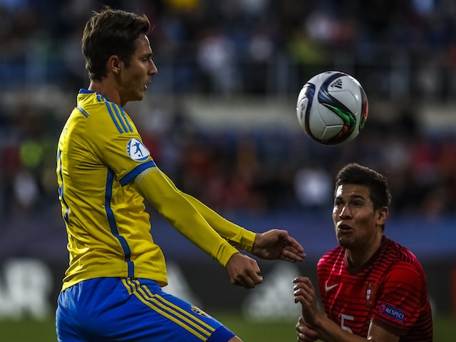 Raphael Guerreiro (R) of Portugal battles for the ball with Branimir Hrgota (L) of Sweden during UEFA U21 European Championship Group B match between Portugal and Sweden at Mestsky Fotbalovy Stadium on June 24, 2015