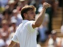 David Goffin of Belgium celebrates a point in his Gentlemen's Singles Third Round match against Marcos Baghdatis of Cyprus during day five of the Wimbledon Lawn Tennis Championships at the All England Lawn Tennis and Croquet Club on July 3, 2015