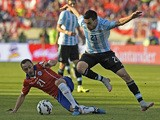 Argentina's midfielder Javier Pastore and Chile's midfielder Marcelo Diaz vie for the ball during their 2015 Copa America football championship final, in Santiago, Chile, on July 4, 2015