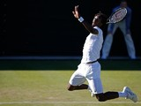 France's Gael Monfils jumps to return the ball to Spain's Pablo Carreno-Busta during their men's singles first round match on day two of the 2015 Wimbledon Championships at The All England Tennis Club in Wimbledon, southwest London, on June 30, 2015