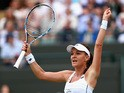 Agnieszka Radwanska of Poland celebrates match point during her Ladies Singles Quarter Final match against Madison Keys of the United States during day eight of the Wimbledon Lawn Tennis Championships at the All England Lawn Tennis and Croquet Club on Jul
