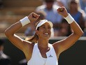 Garbine Muguruza of Spain celebrates victory in her Ladies' Singles Fourth Round match against Caroline Wozniacki of Denmark during day seven of the Wimbledon Lawn Tennis Championships at the All England Lawn Tennis and Croquet Club on July 6, 2015