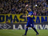 Boca Juniors' midfielder Juan Roman Riquelme waves while leaving the field during their Argentine First Division football match against Quilmes, at the Bombonera stadium in Buenos Aires, Argentina, on September 29, 2013