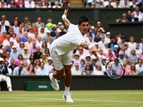Novak Djokovic of Serbia plays a backhand volley in the Final Of The Gentlemen's Singles against Roger Federer of Switzerland on day thirteen of the Wimbledon Lawn Tennis Championships at the All England Lawn Tennis and Croquet Club on July 12, 2015