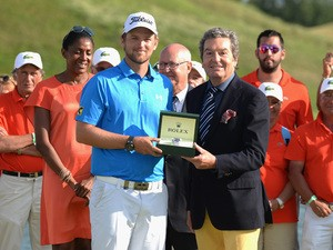 Bernd Wiesberger of Austria receives a Rolex watch after winning the Alstom Open de France - Day Four at Le Golf National on July 5, 2015
