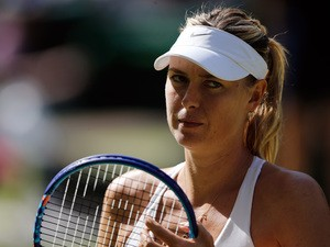 Russia's Maria Sharapova reacts after a point against US player Serena Williams during their women's semi-final match on day ten of the 2015 Wimbledon Championships at The All England Tennis Club in Wimbledon, southwest London, on July 9, 2015