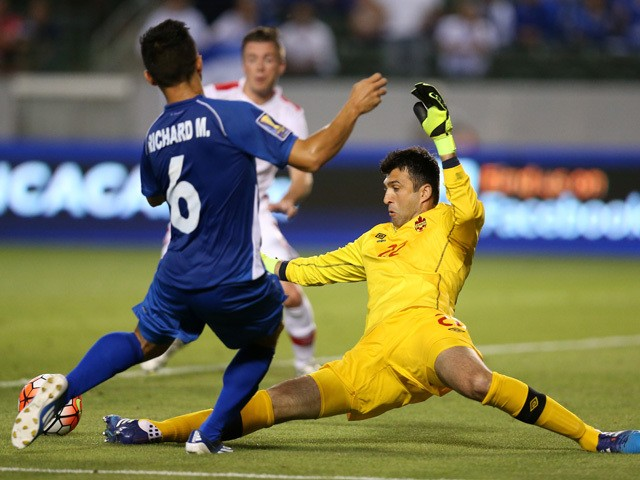 Kryiakos Stamatopolous #22 of Canada kicks the ball away from Ricahrd Menjivar #6 of El Salvador in their CONCACAF Gold Cup Group B match at StubHub Center on July 8, 2015